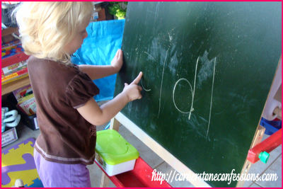 Erasing letters on the chalkboard with fingers