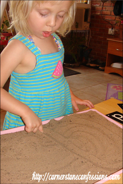 "Writing a ""d"" in the sand"