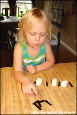 Creating black and white patterns with marshmallows and licorice sticks.  Yum!
