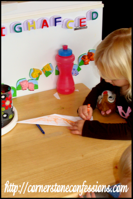 Coloring her paper airplane