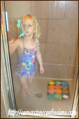 Painting the shower with shaving cream paint.  She loved this...and the fact that it looked like she was painting mommy's face while she did it thanks to the shower door.