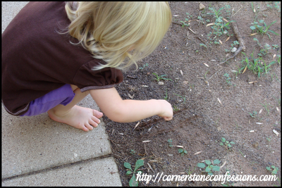 Writing letters in the dirt