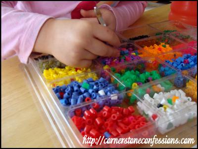 Sorting beads with tweezers