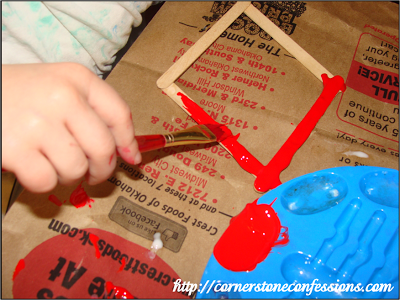 Creating a picture frame that we ended up covering with silver glitter